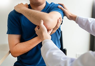 Doctor examining personal injury to arm